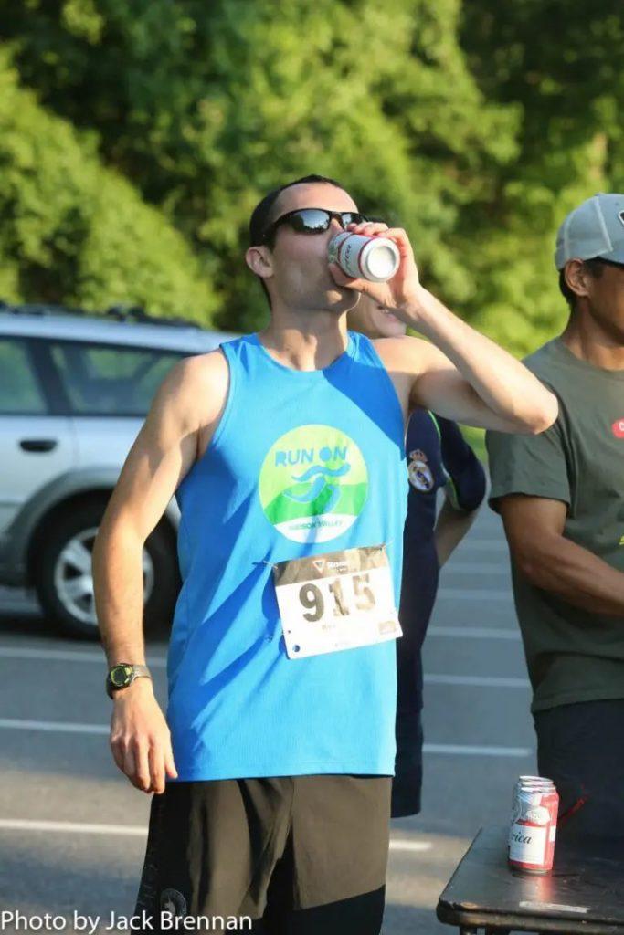 runner drinking beer